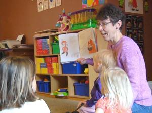 Child care provider educating children.