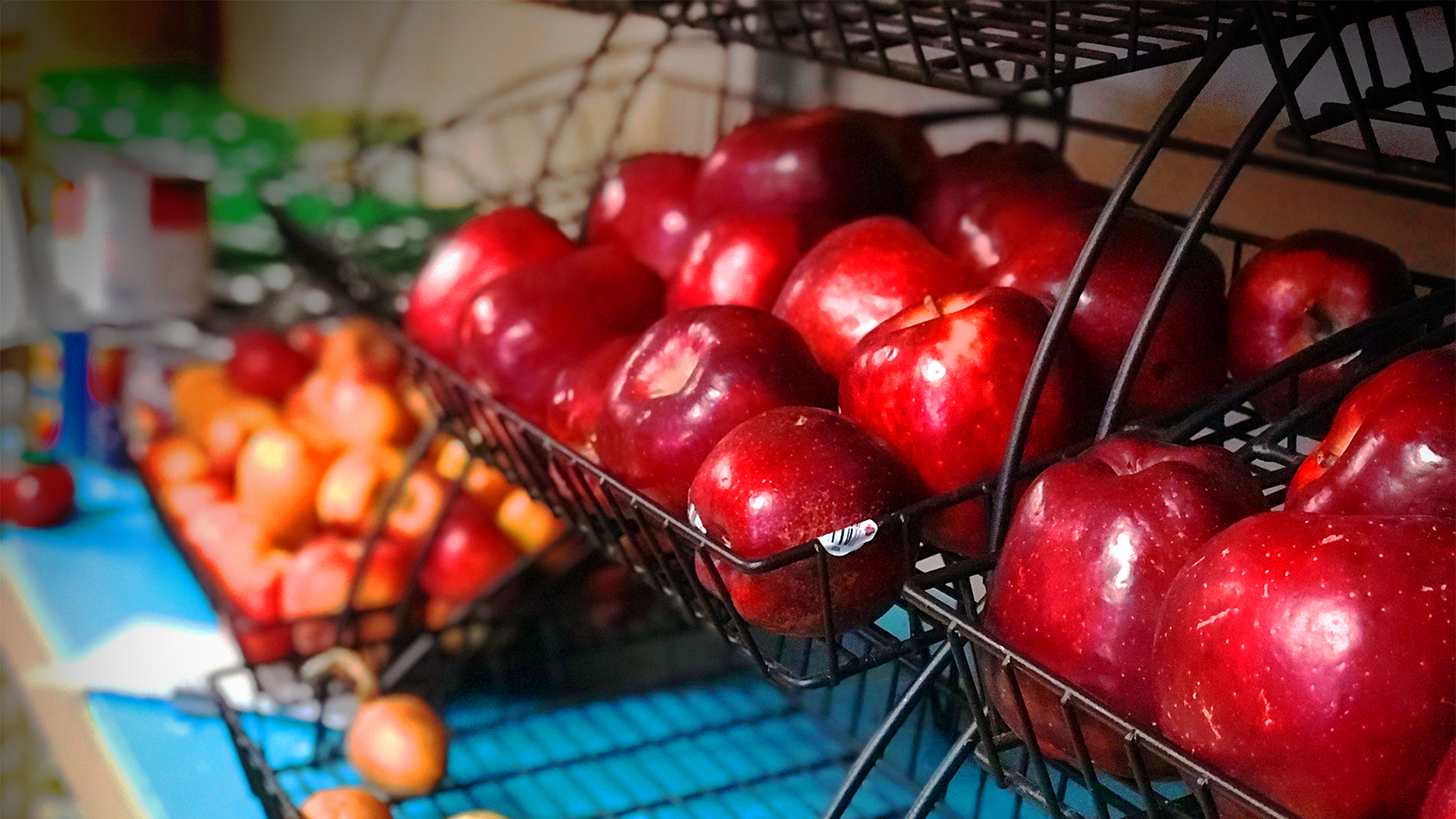 A basket of apples in a food shelf