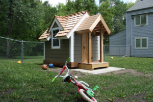 Play house with a bike in front of it