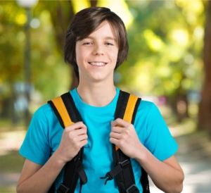 Boy with a backpack on his way to school
